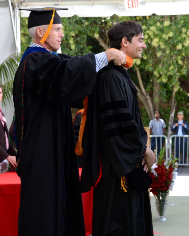 Ousterhout placing academic hood on Ongaro